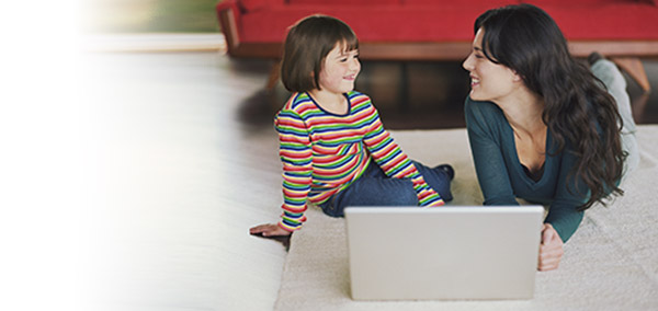 Mother and daughter watching TV Everywhere on a laptop computer